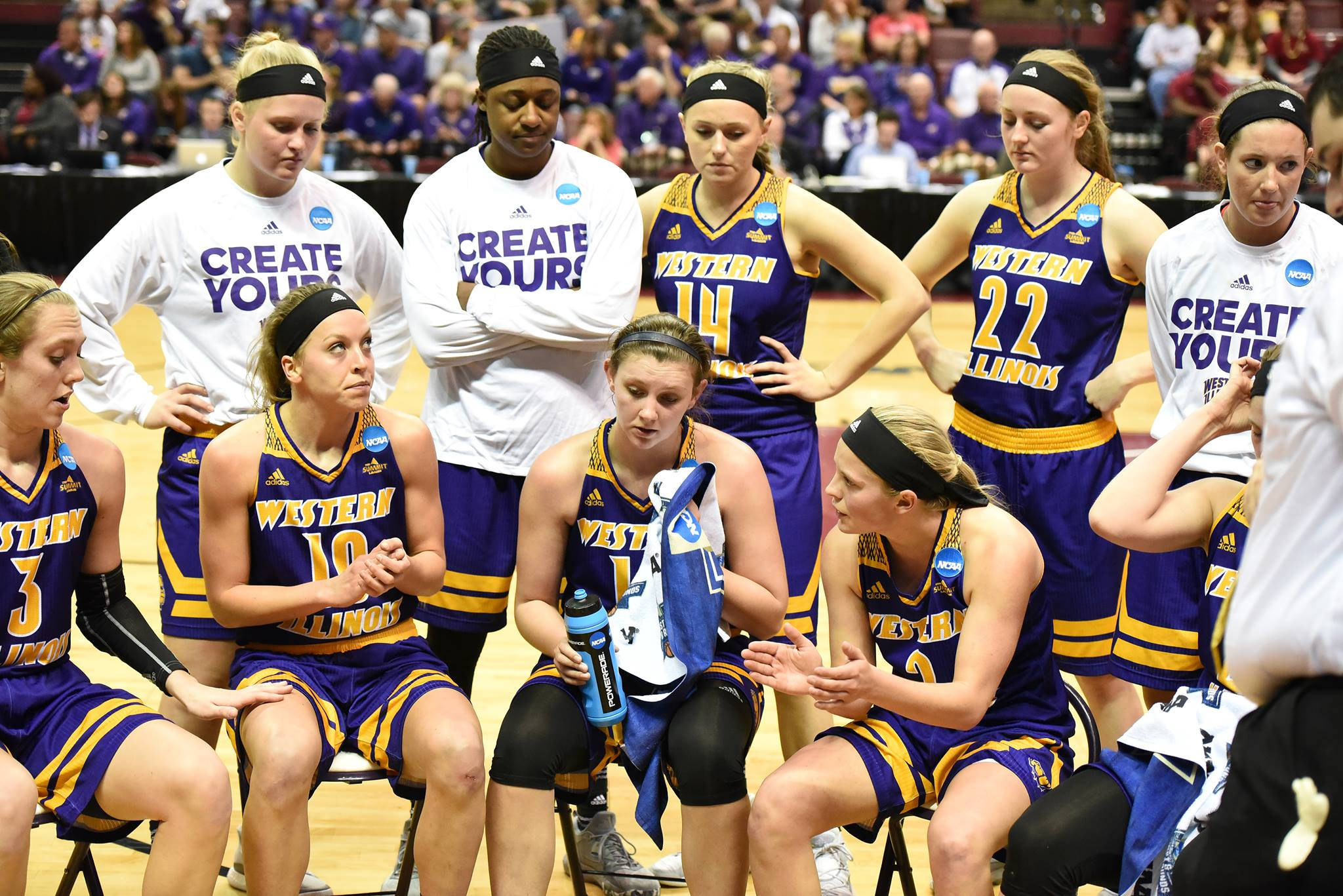 The Lady Leathernecks huddle together with women's basketball head coach JD Gravina to talk strategy during the NCAA Tournament as Western Illinois takes on 3-seed Florida Seminoles on March 17.