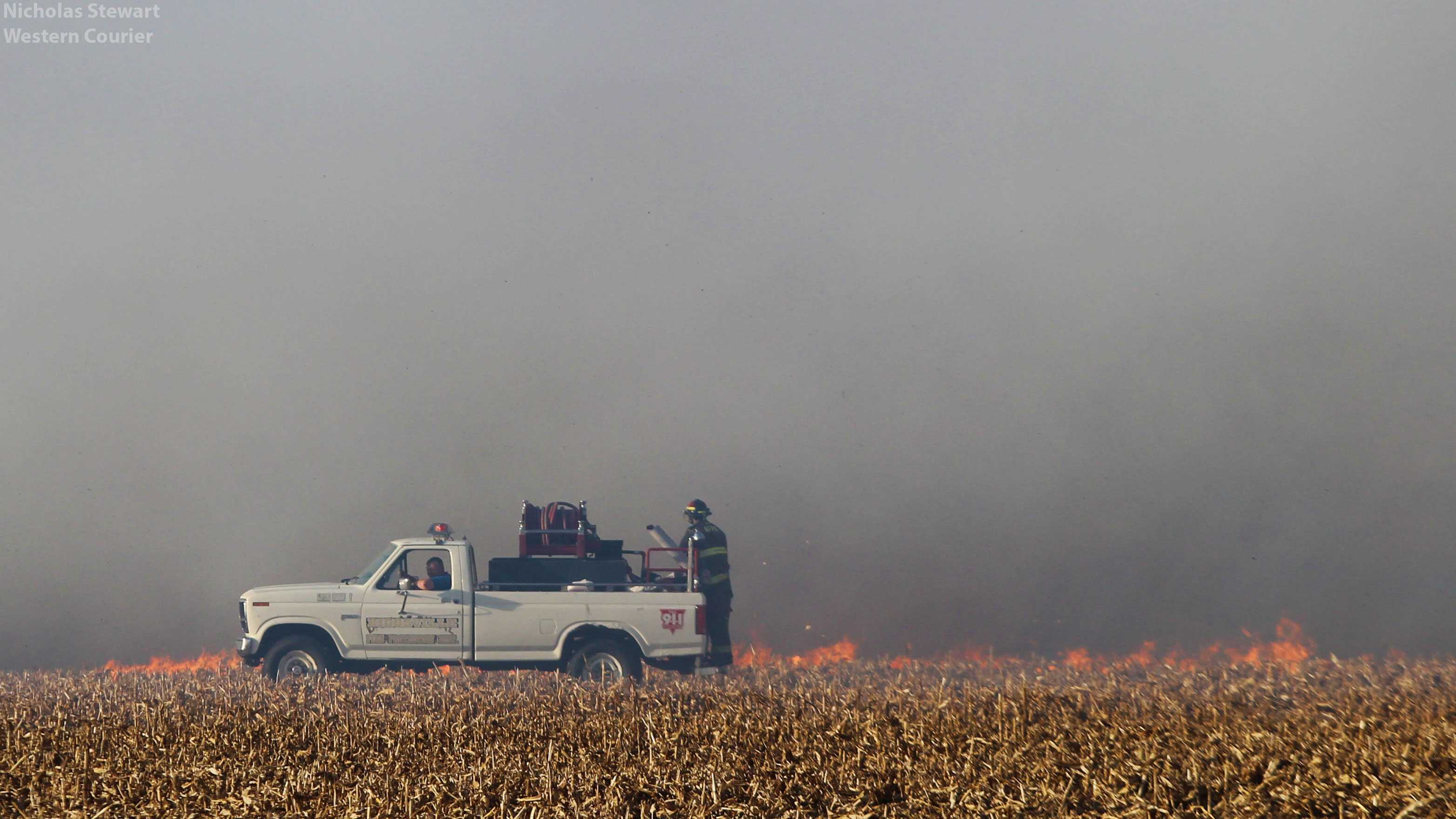 Firefighters use one of the many firefighting vehicles to combat the field fire. Last Monday's fire required mutual aid from several local departments.