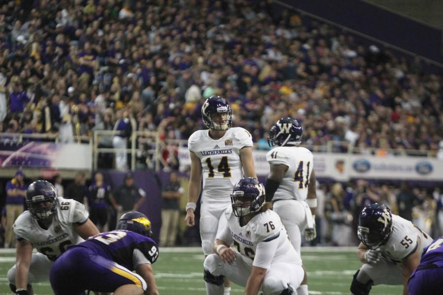 Quarterback Trenton Norvell (14) surveys the field on third and five at the Northern Iowa nine-yard line.