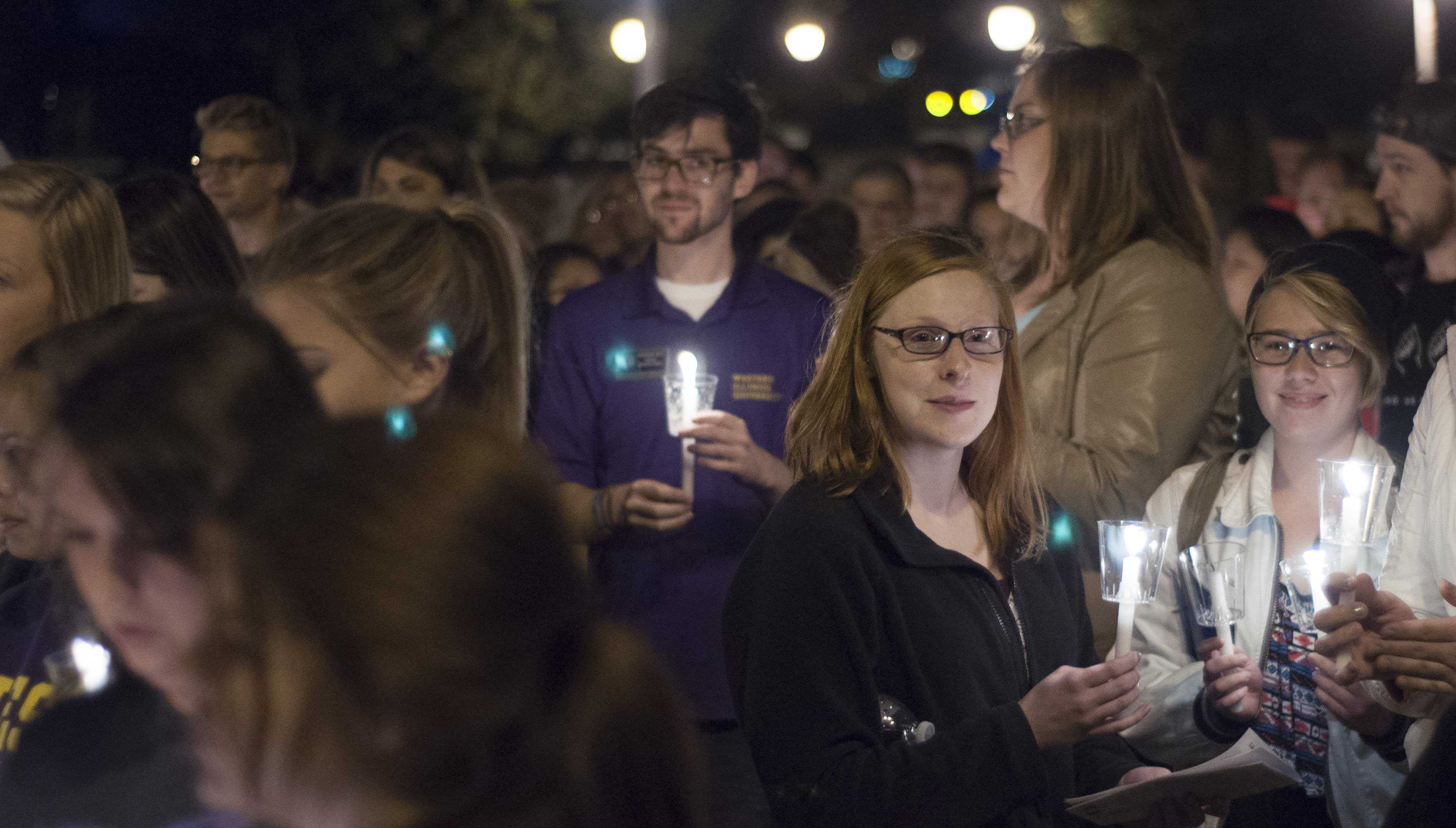 Students gather outside of Sherman Hall before marching through the streets of Macomb during the 26th annual Take Back the Night event.