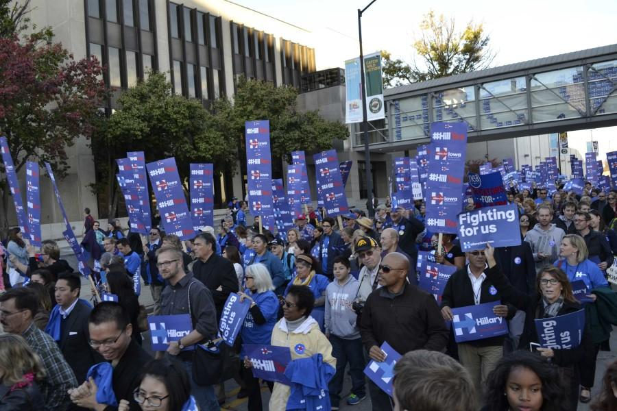 Hundreds of Hillary Clinton supporters march to Hy-Vee Hall following the Jefferson-Jackson Dinner rally.