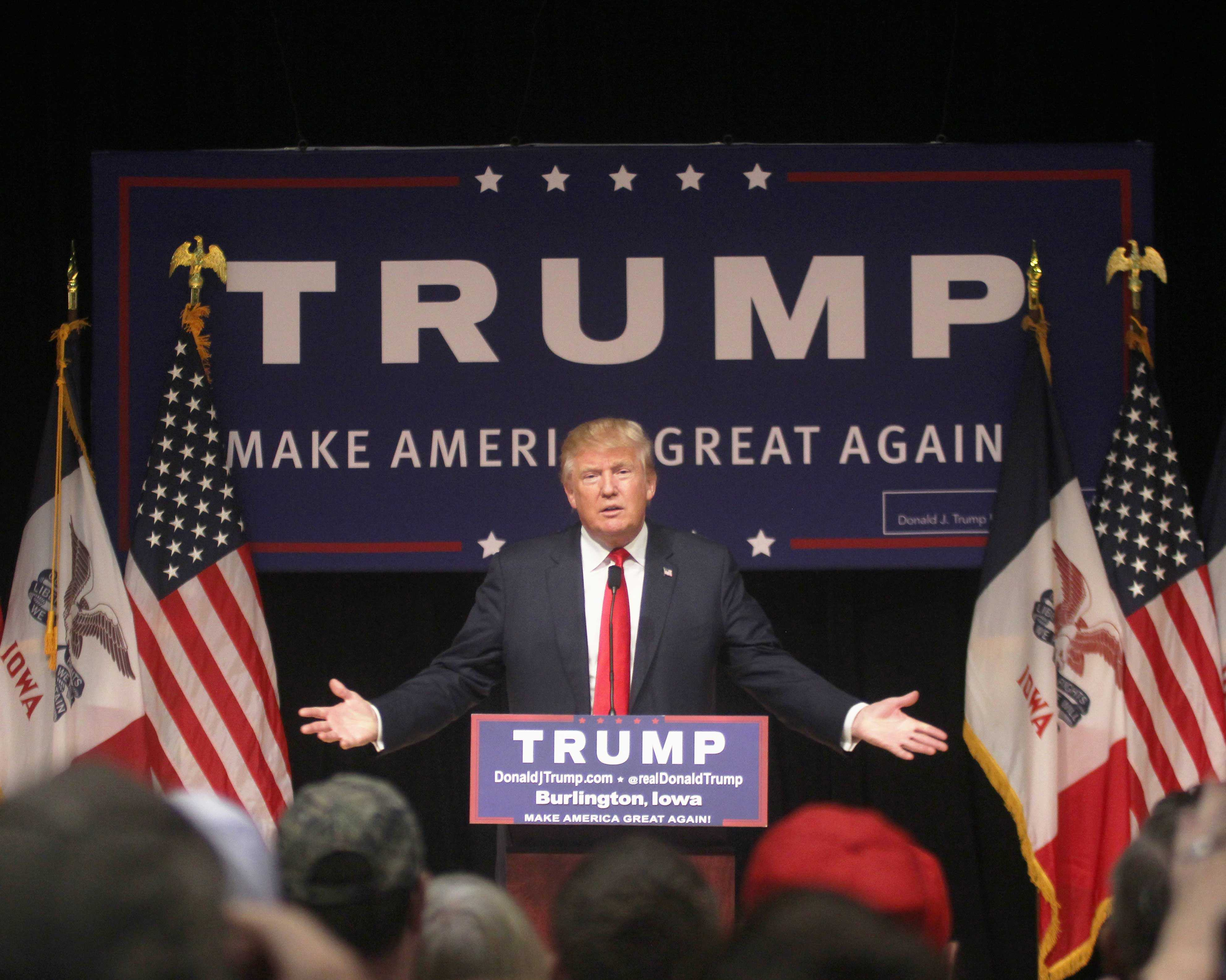 Donald Trump, the current Republican presidential frontrunner, speaks to a crowd of over 2,000 on Oct. 21 in Burlington, Iowa for a campaign rally.  Trump's speech criticizes President Barack Obama and past Republican candidates John McCain and Mitt Romney.