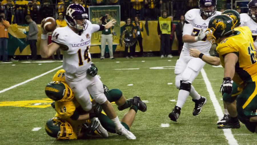 Western Illinois quarterback Trenton Norvell is pulled down by a pair of Bison defenders. The Leathernecks managed only 205 yards of total offense, opposed to 528 by NDSU.