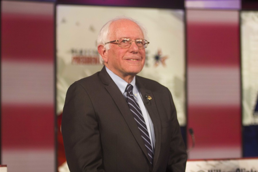Sen. Bernie Sanders poses for photos prior to the start of the second Democrat debate.