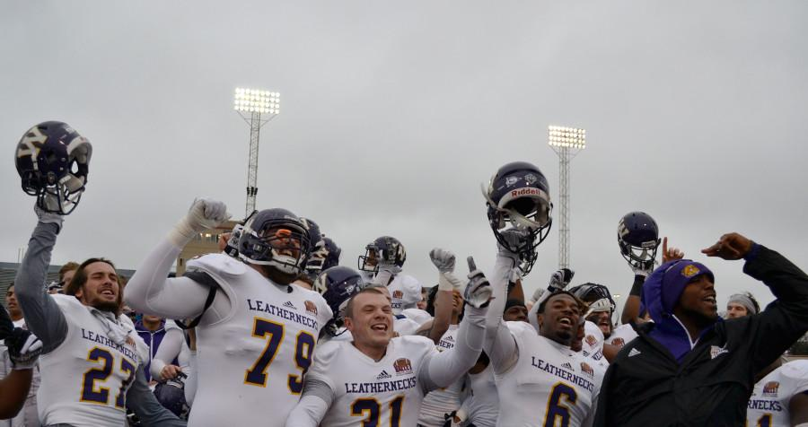 The Leathernecks celebrate after defeating Dayton 24-7 in the first round of the FCS playoffs at Welcome Stadium, creating a rematch with Illinois State next Saturday in Round 2.