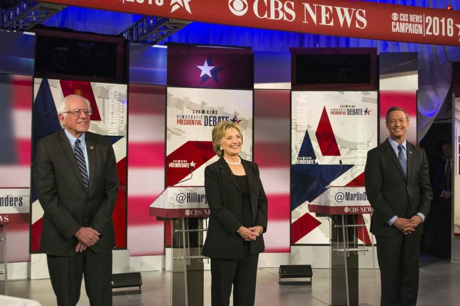 Vermont Sen. Bernie Sanders (left), former Secretary of State Hillary Clinton (center) and former Maryland Gov. Martin O'Malley pose for photos prior to the start of the second Democrat Debate.