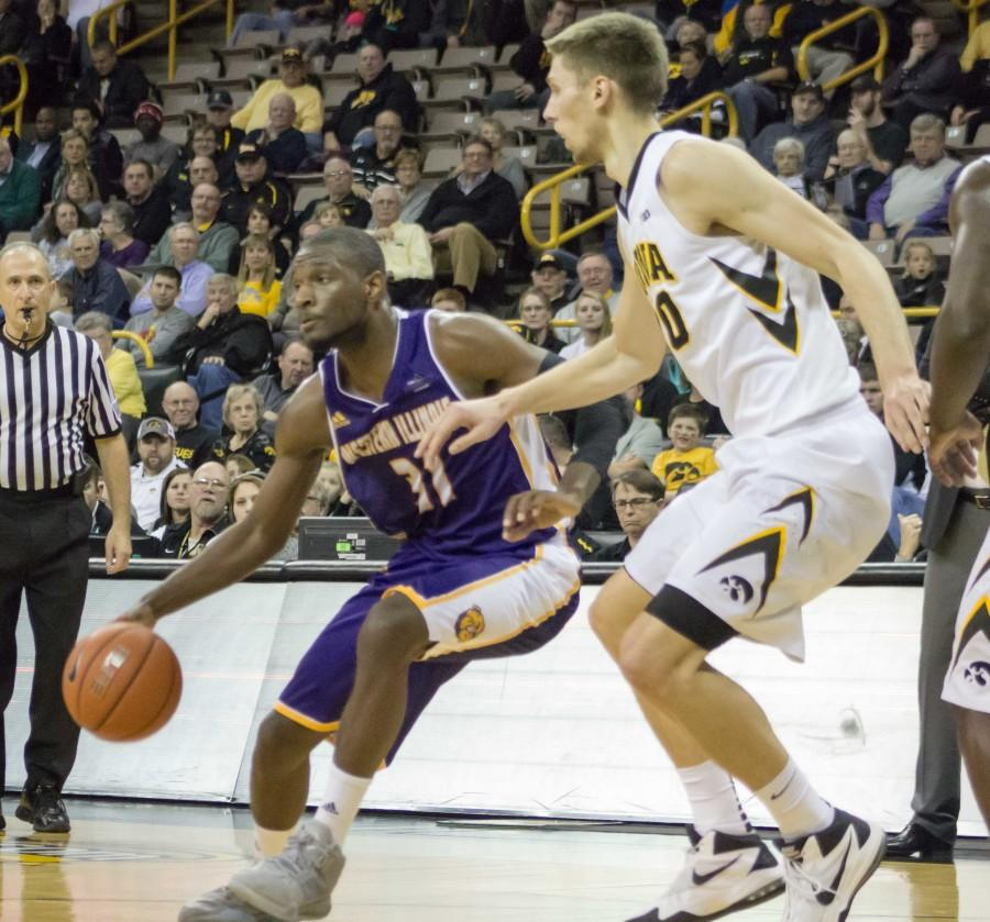 Iowa forward Jarrod Uthoff guards Garret Covington (31) in the first half on Monday, en route to his 27-point, nine-rebound performance.