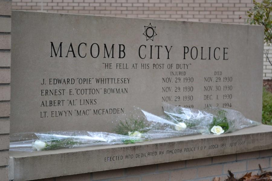 Friends and relatives of the slain police officers laid flowers on the memorial for fallen Macomb Police Officers.