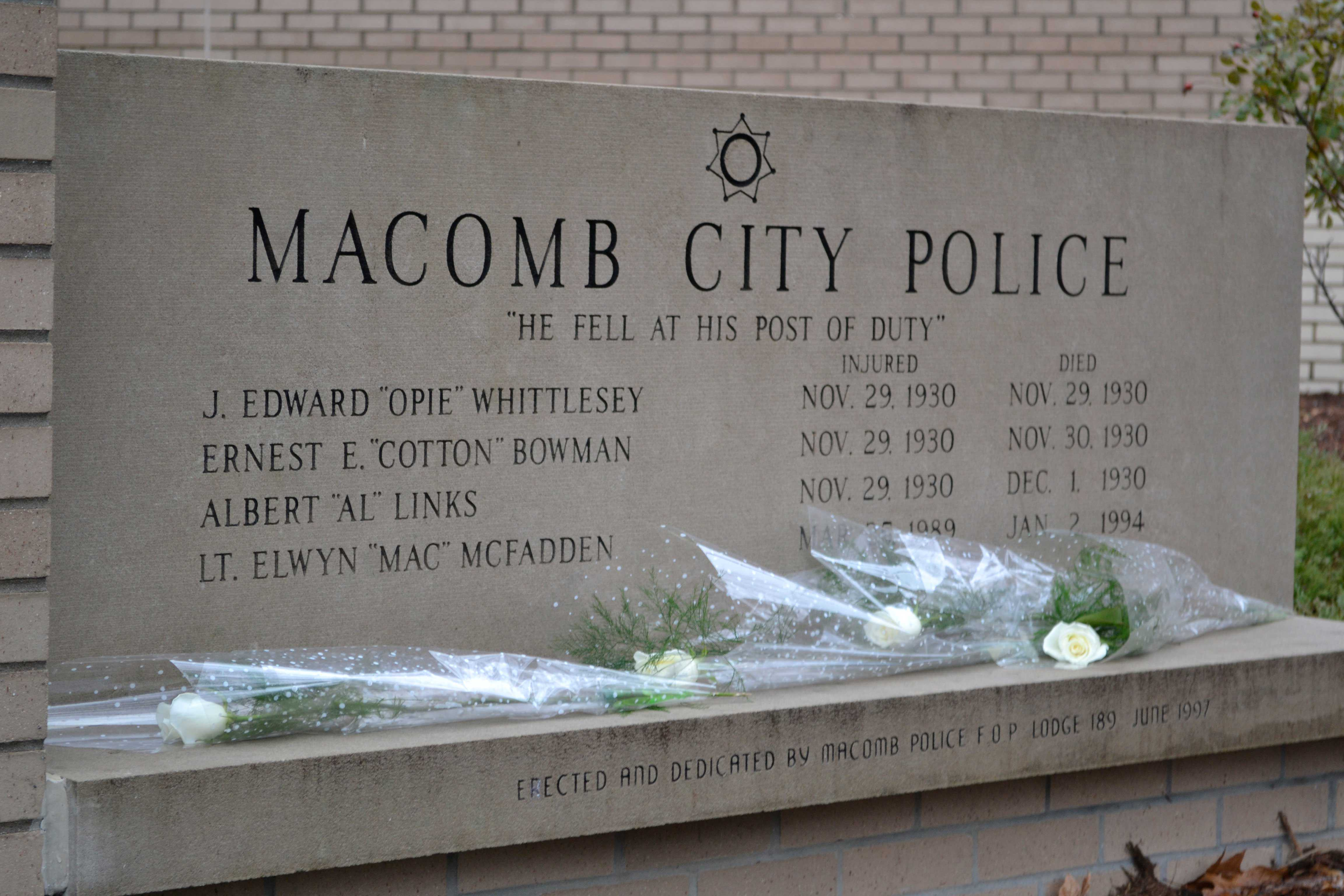 3b5cda741aa3b Friends and relatives of the slain police officers laid flowers on the  memorial for fallen Macomb