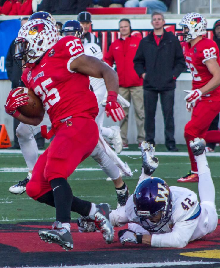 ISU running back Marshaun Coprich (25) breaks loose for a 72-yard touchdown run, putting the game out of reach in the fourth quarter.