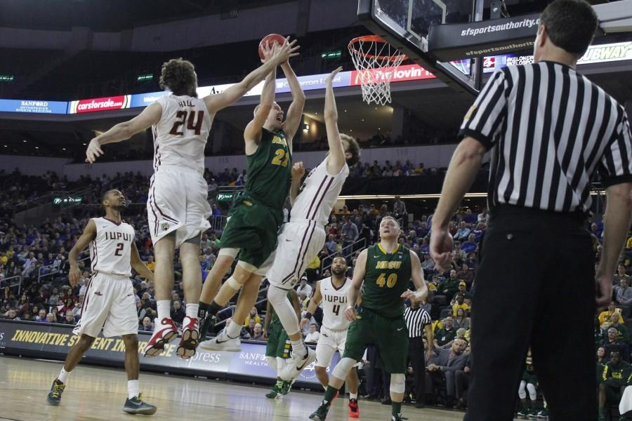 A.J. Jacobson scores 14 points for the NDSU Bison en route to an upset victory over the IUPUI Jaguars.