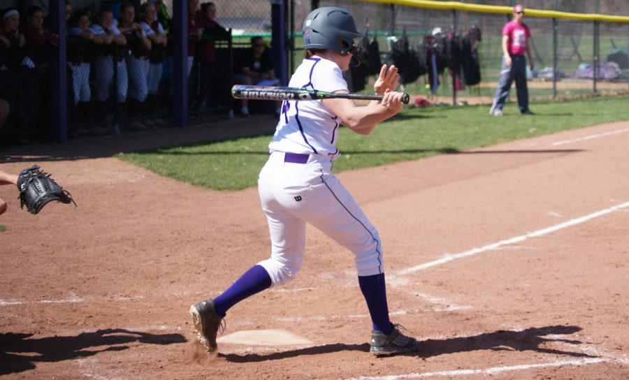 One+of+the+bright+spots+for+the+Leathernecks%2C+Rachel+Beatty+delivers+one+of+two+hits+in+Game+1+of+the+doubleheader.+