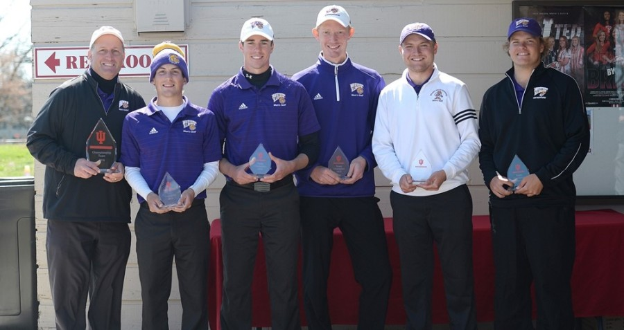 Members of the Western Illinois men's golf team hold their trophies after placing first at the Hoosier Invitational.
