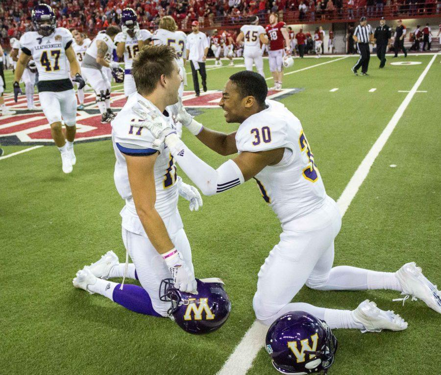 No. 17 Jaelon Acklin and No. 30 Justin Fitzpatrick celebrate Western's 35-34 win over South Dakota. Acklin's fourth down catch led to the winning score for the Leathernecks.