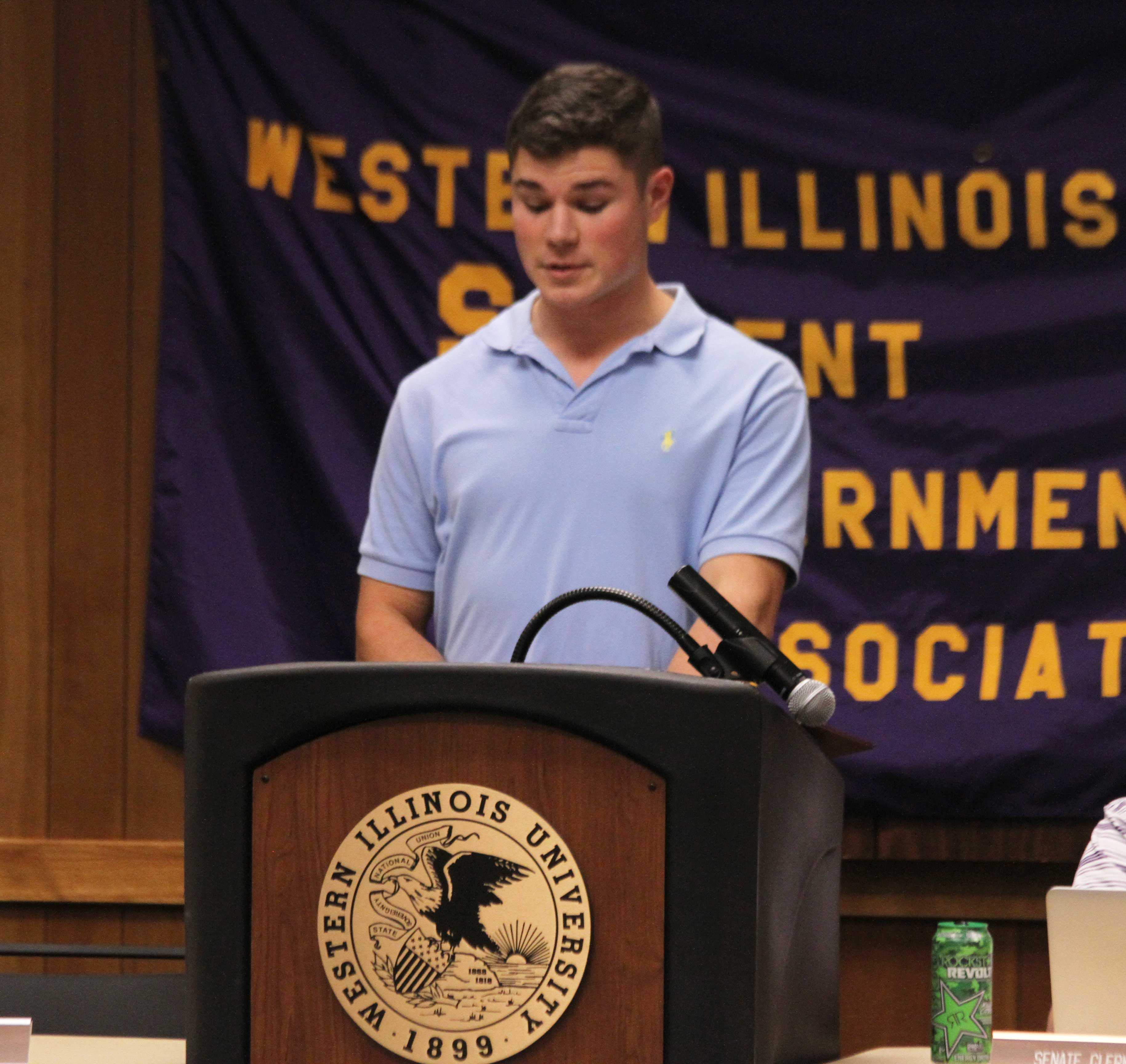 Speaker of the Senate Andrew Mueller presides over the Student Government Association as it discusses a proposition to pay respects for the late Macomb Fire Chief Andy Taylor.