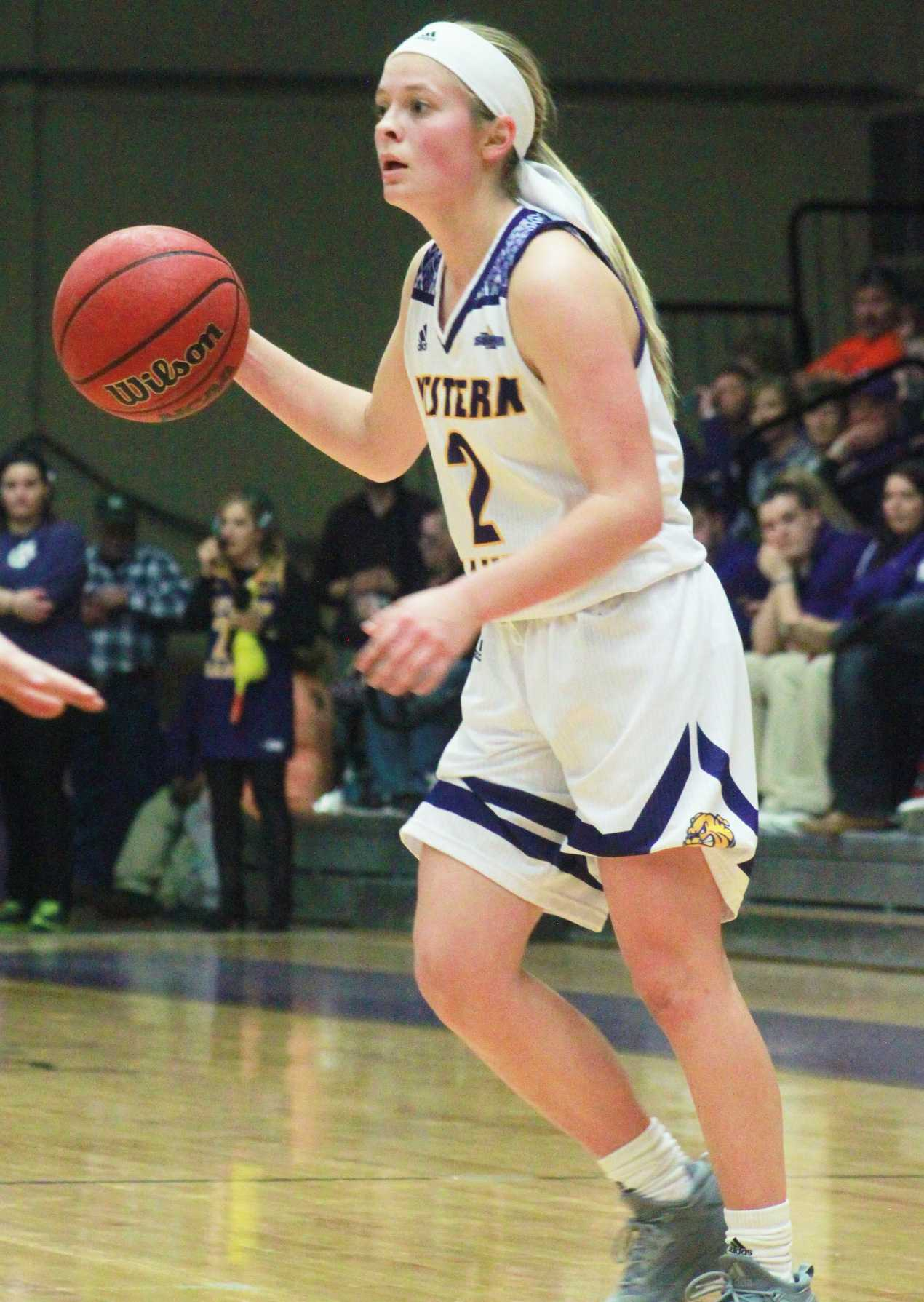 Emily Clemens looks to assist her teammates on senior night at Western Hall.