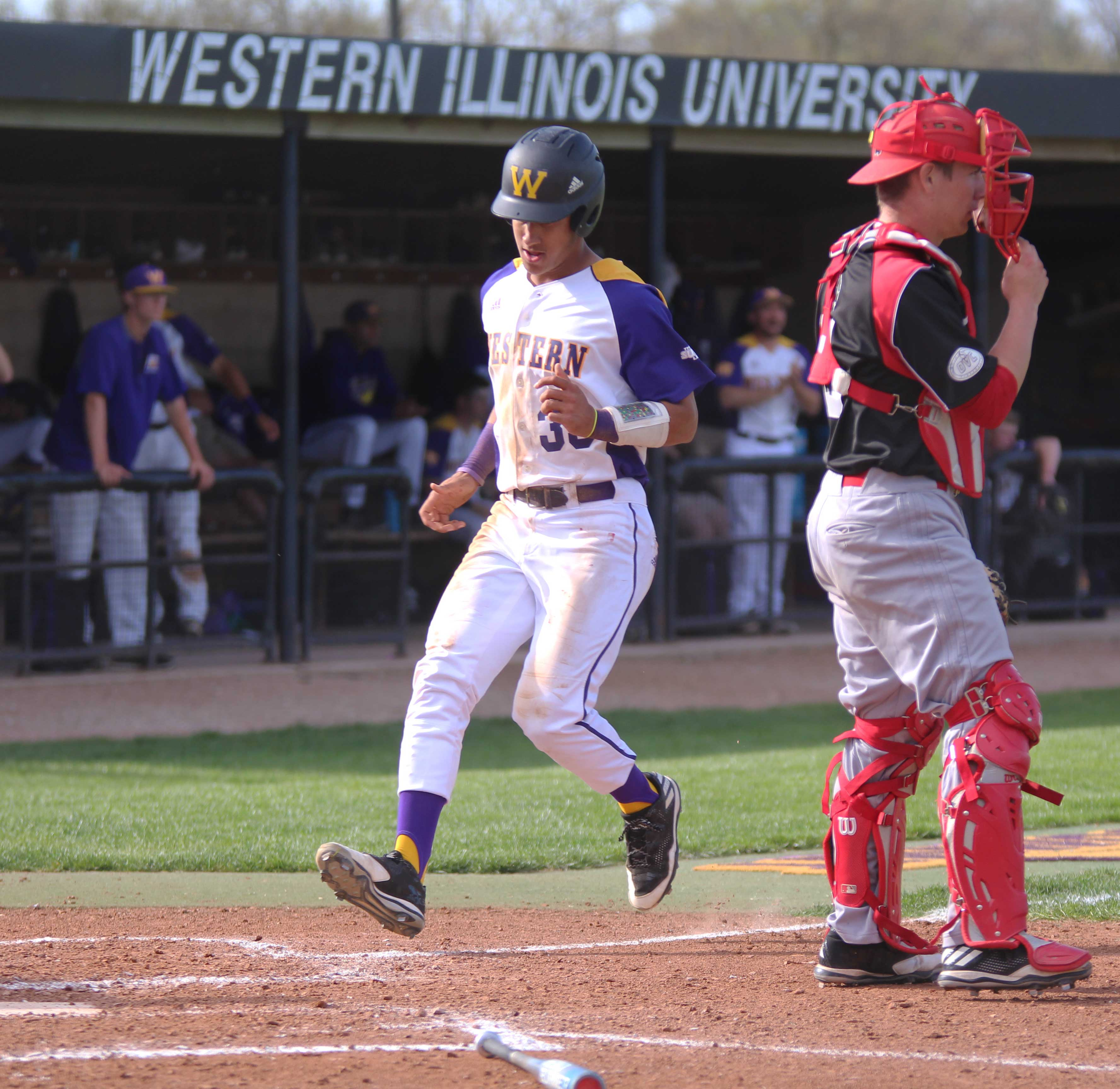 Sophomore Deion Thompson crosses home plate at Alfred D. Boyer Stadium in Macomb