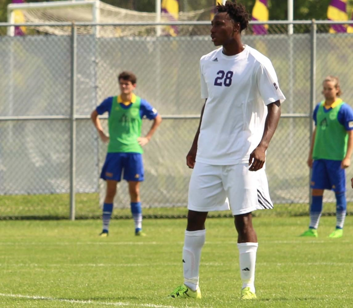 Armel+Kouassi+playing+defense+in+the+first+exhibition+match+of+the+season+for+the+Leathernecks.