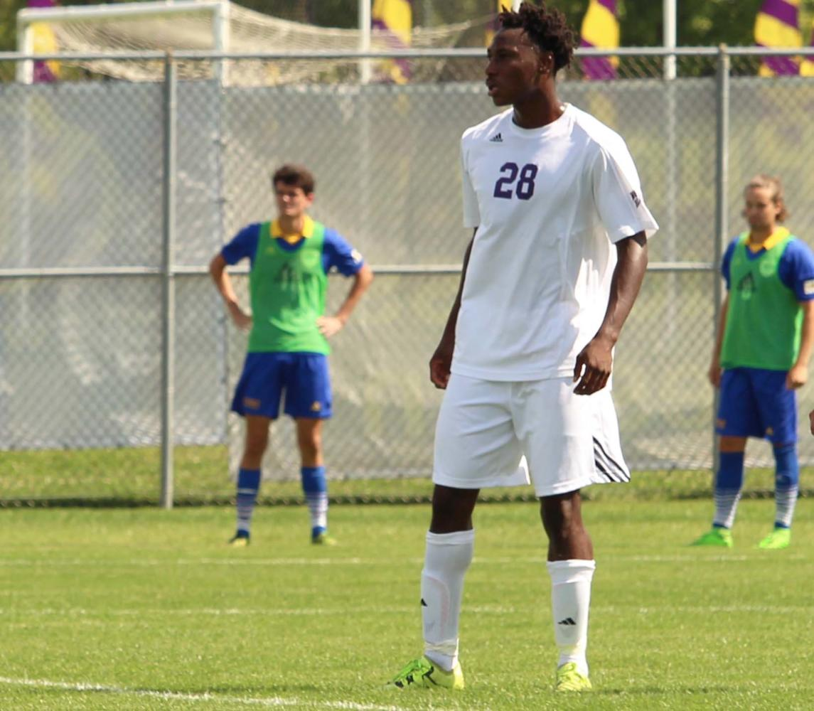 Armel Kouassi playing defense in the first exhibition match of the season for the Leathernecks.