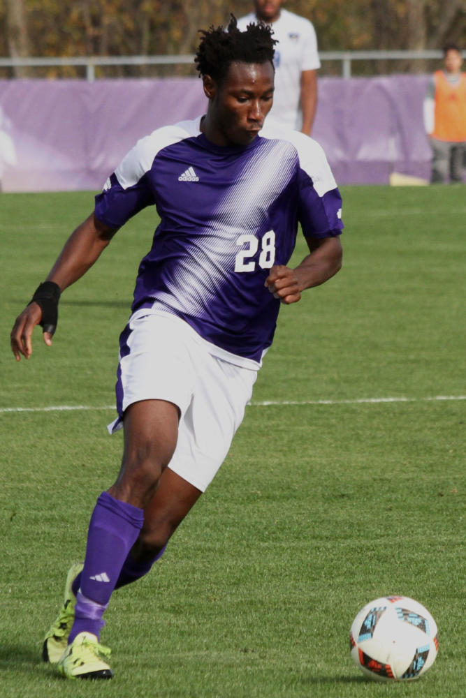 Armel Kouassi looks for a shot in Western's final exhibiton game of the season.