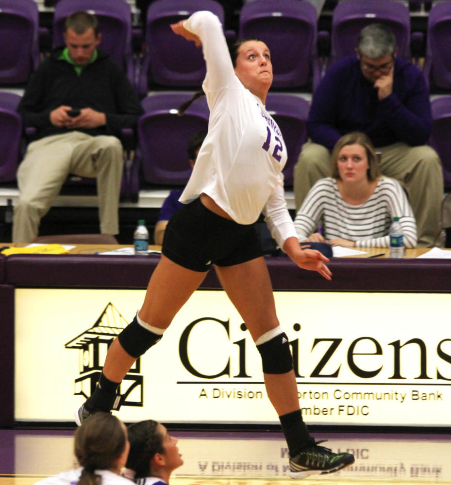 Senior, Shalyn Greenhaw helps the Leathernecks score witha spike.