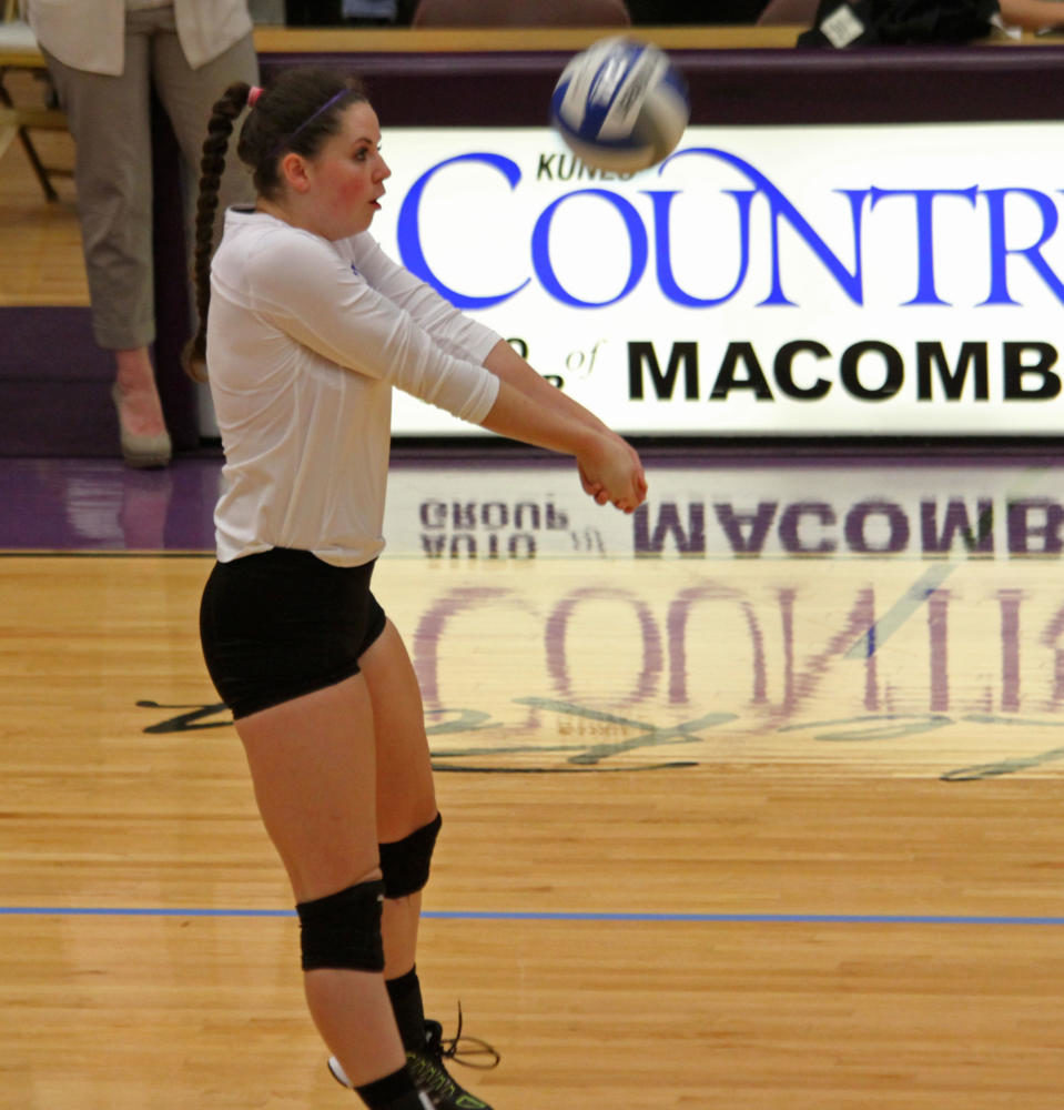 Melanie Paenaude bumps the ball to try and set up a Western point at the BWW Invitational.
