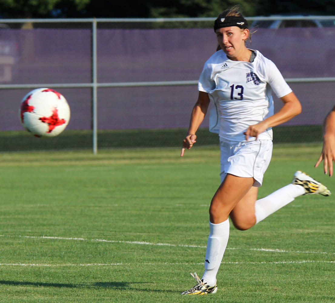 Ashley Kuhlman pushing the ball up the field in the Leathernecks first win.