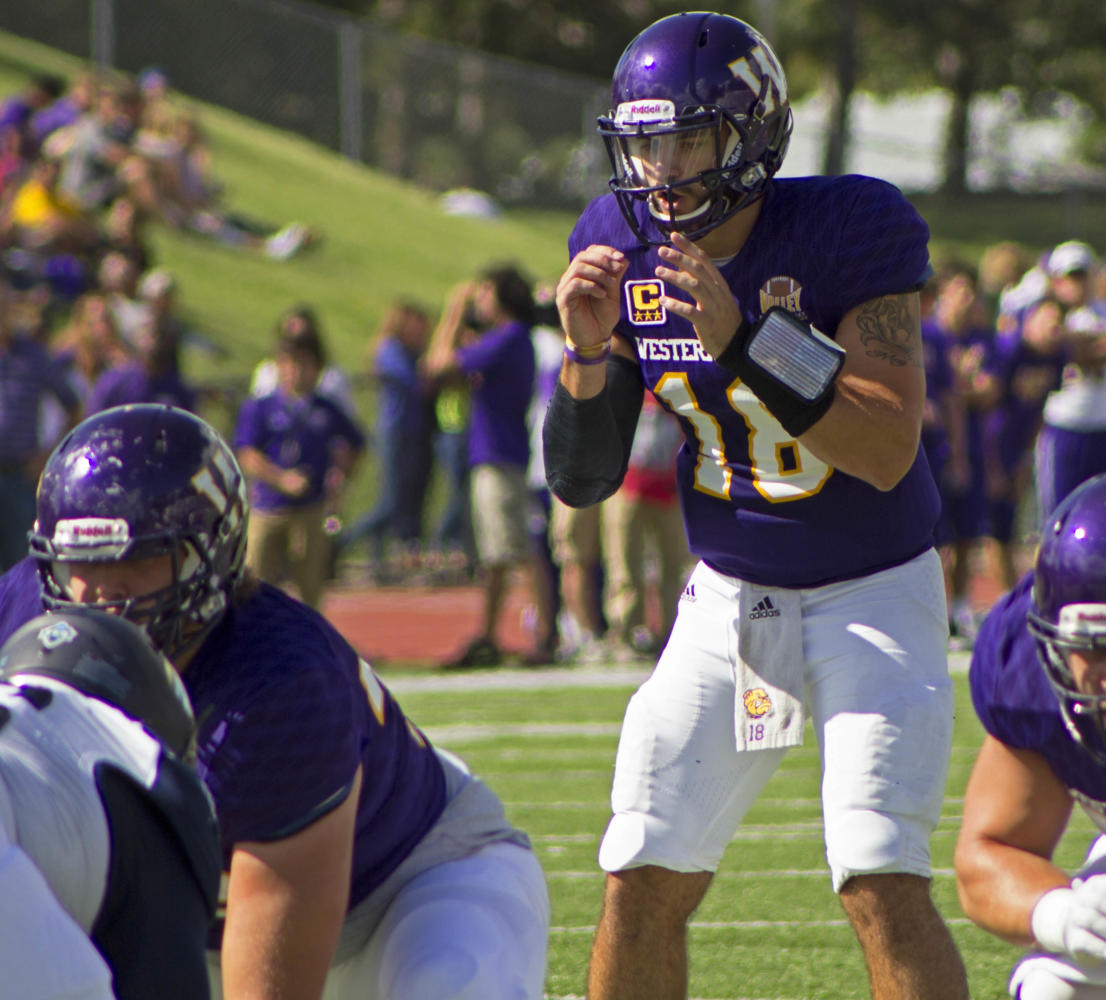 Sean+McGuire+takes+a+snap+in+a+Leatherneck+home+game+last+season+agianst+Northern+Arizona.+