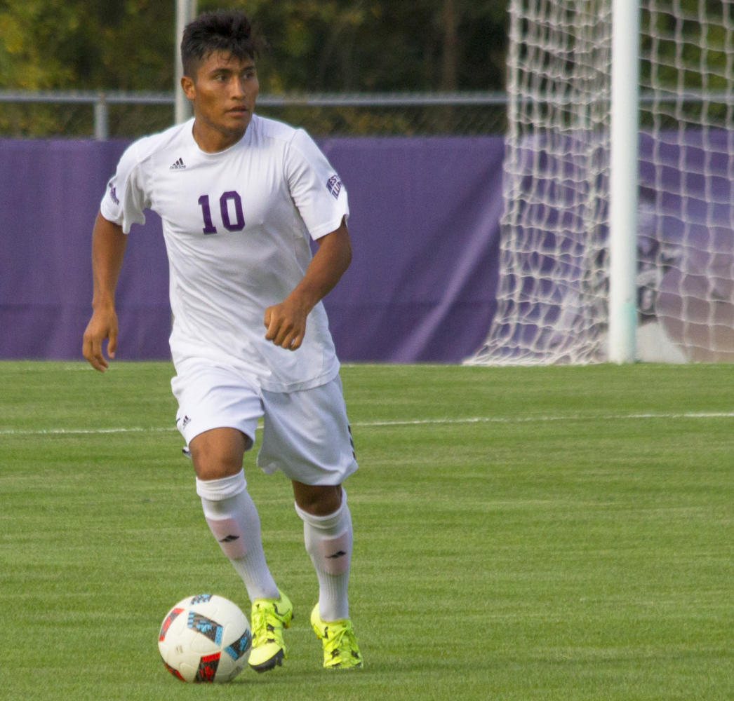 Fernando Pacheco pushes the ball up the field in a loss to Northwestern University.