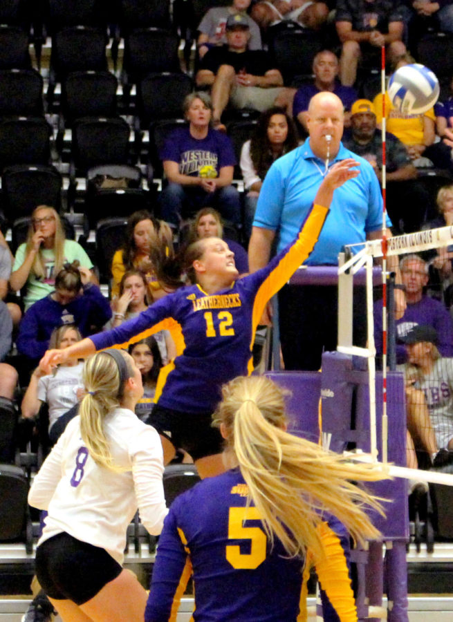 Shayln Greenhaw defends the net in a home game