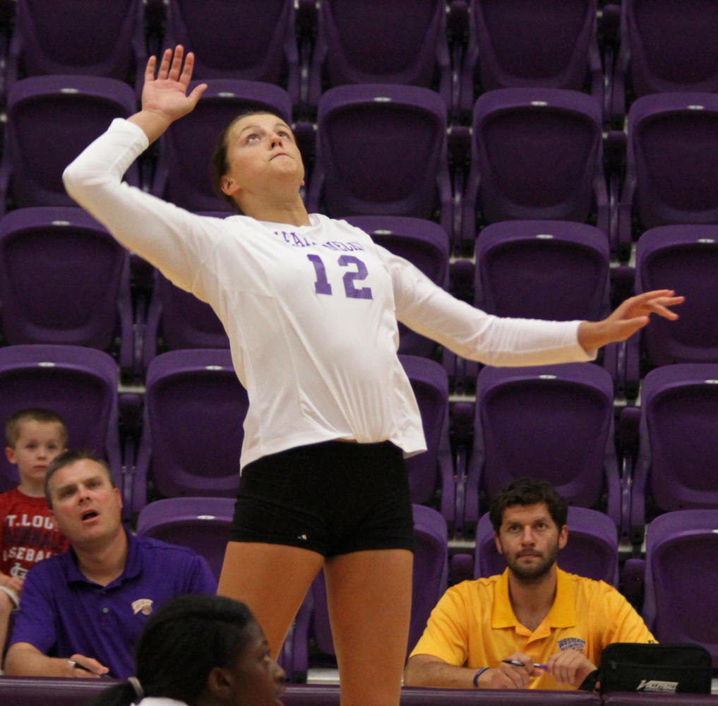 Shalyn Greenhaw goes for the kill for a Leatherneck point in Macomb.