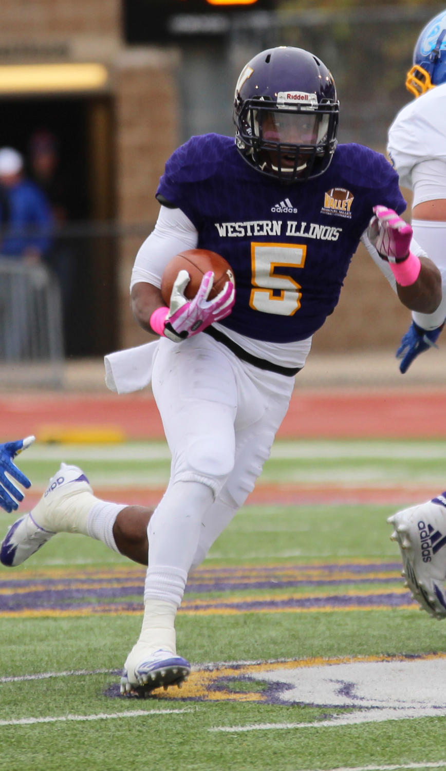 Seteve McShane bursting into open field on a two-touchdown day against South Dakota State University.