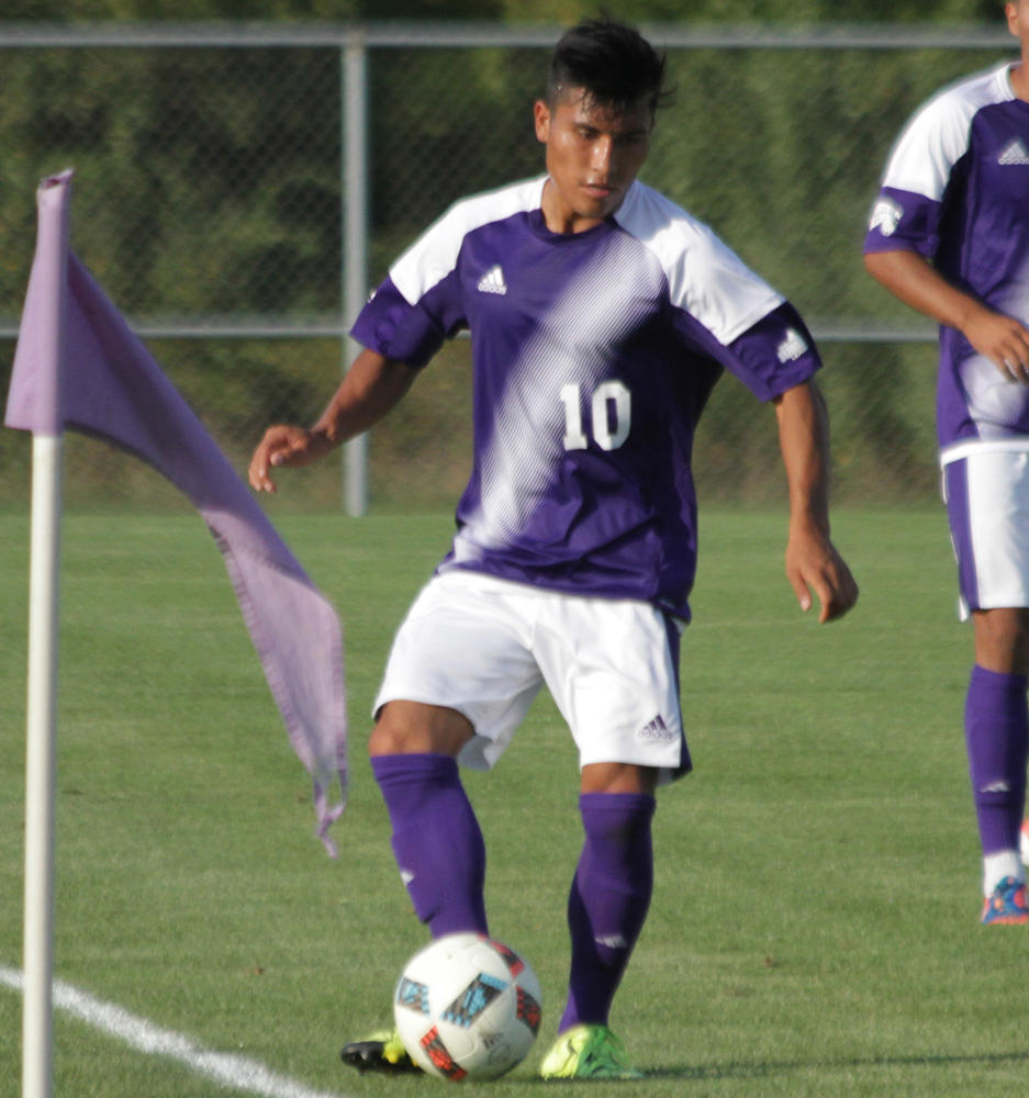 Fernando Pacheco dribbles up the field in a Leatherneck win over Eastern Illinois University.