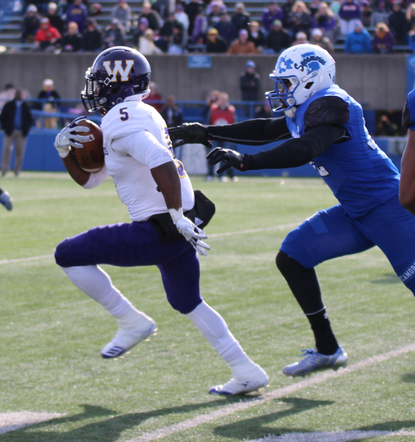 Steve McShane weaves through Indiana State University defenders on his way to a touchdown.