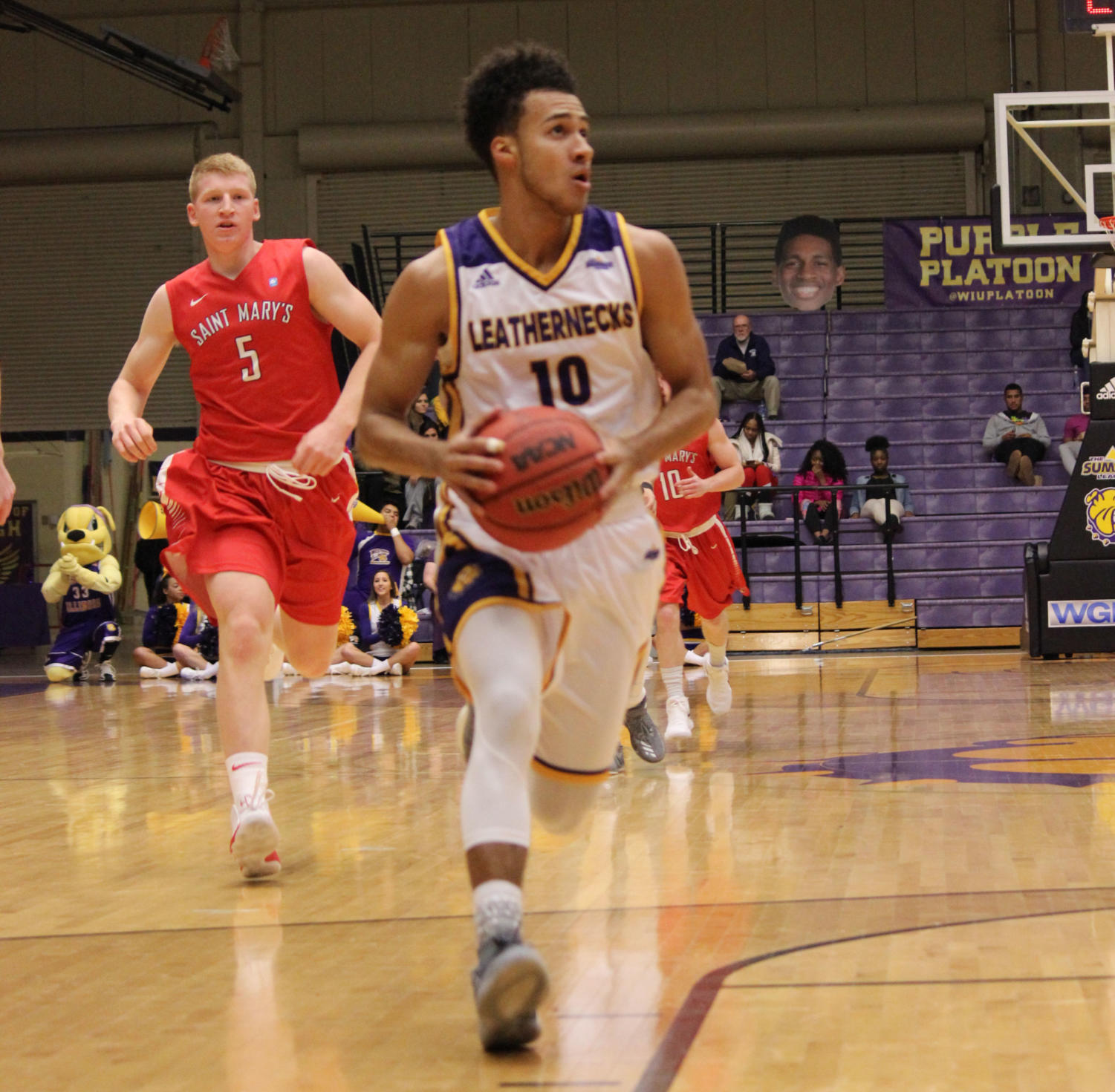 Kobe Webster races down the court on a fast-break to help Western get a victory.