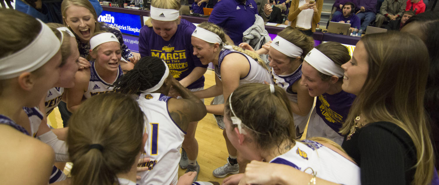 The women's basketball team celebrating their regular season Summit League championship last year.