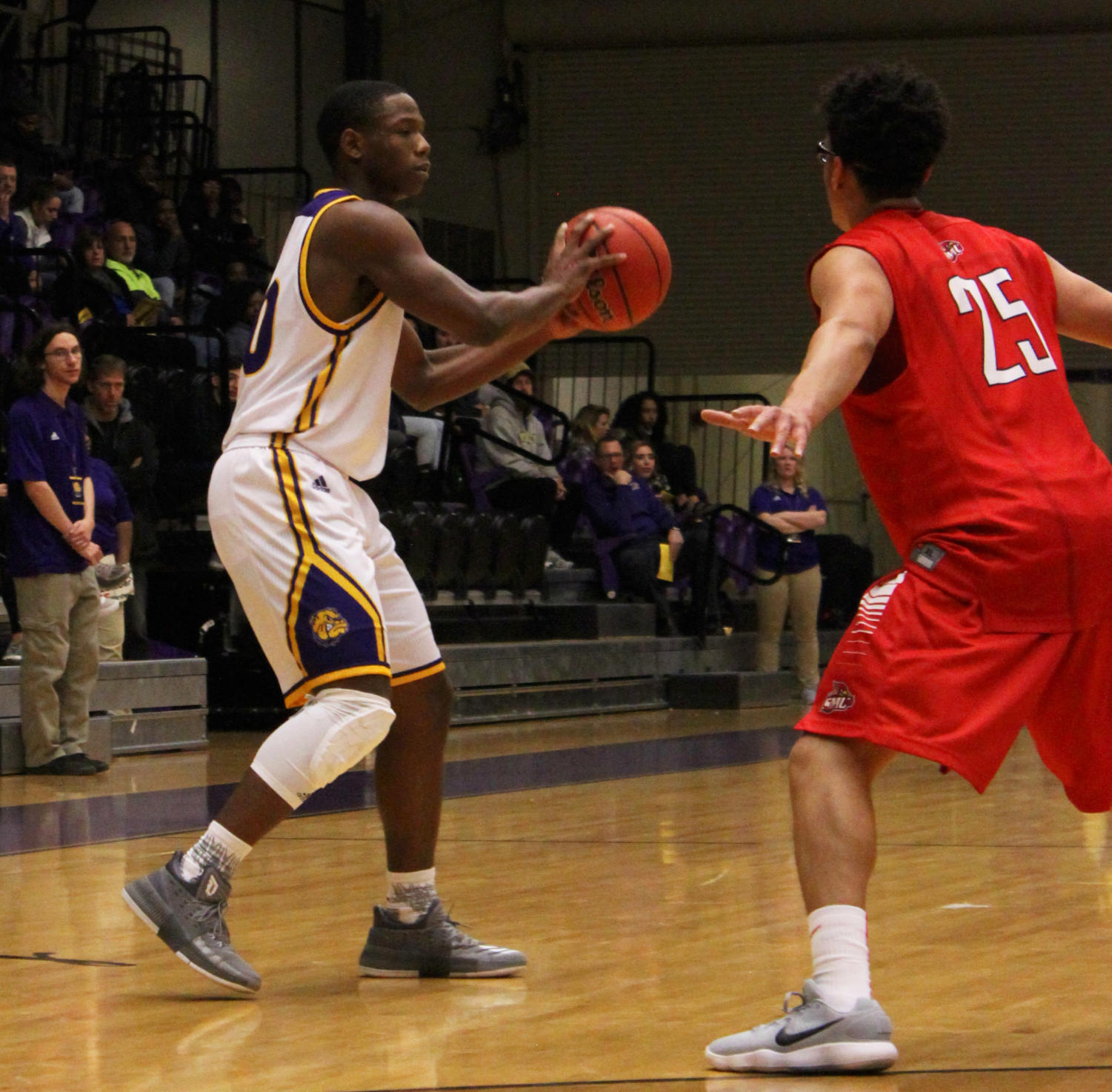 C.J. Duff ball fakes to set up a drive to the hoop for two of his eight points on the night.