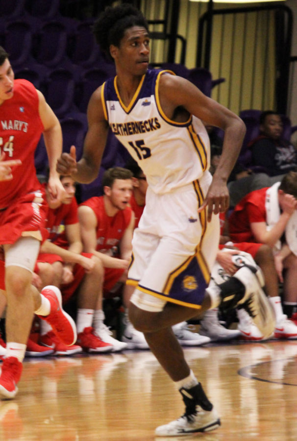 Dalan Ancrum looks for the ball on a Leatherneck fast break.