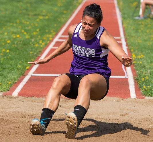 Alyssa Johnson lands in the long jump.