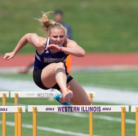 Michaela Bush dashes down the track over the hurdles.