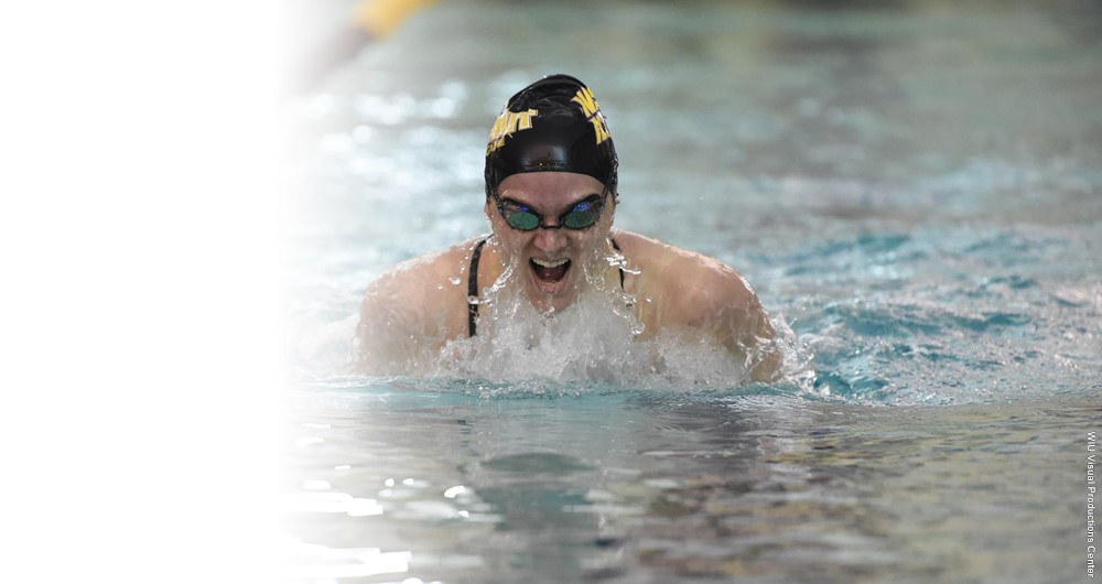 Erica Hagen emerges for air during her relay.
