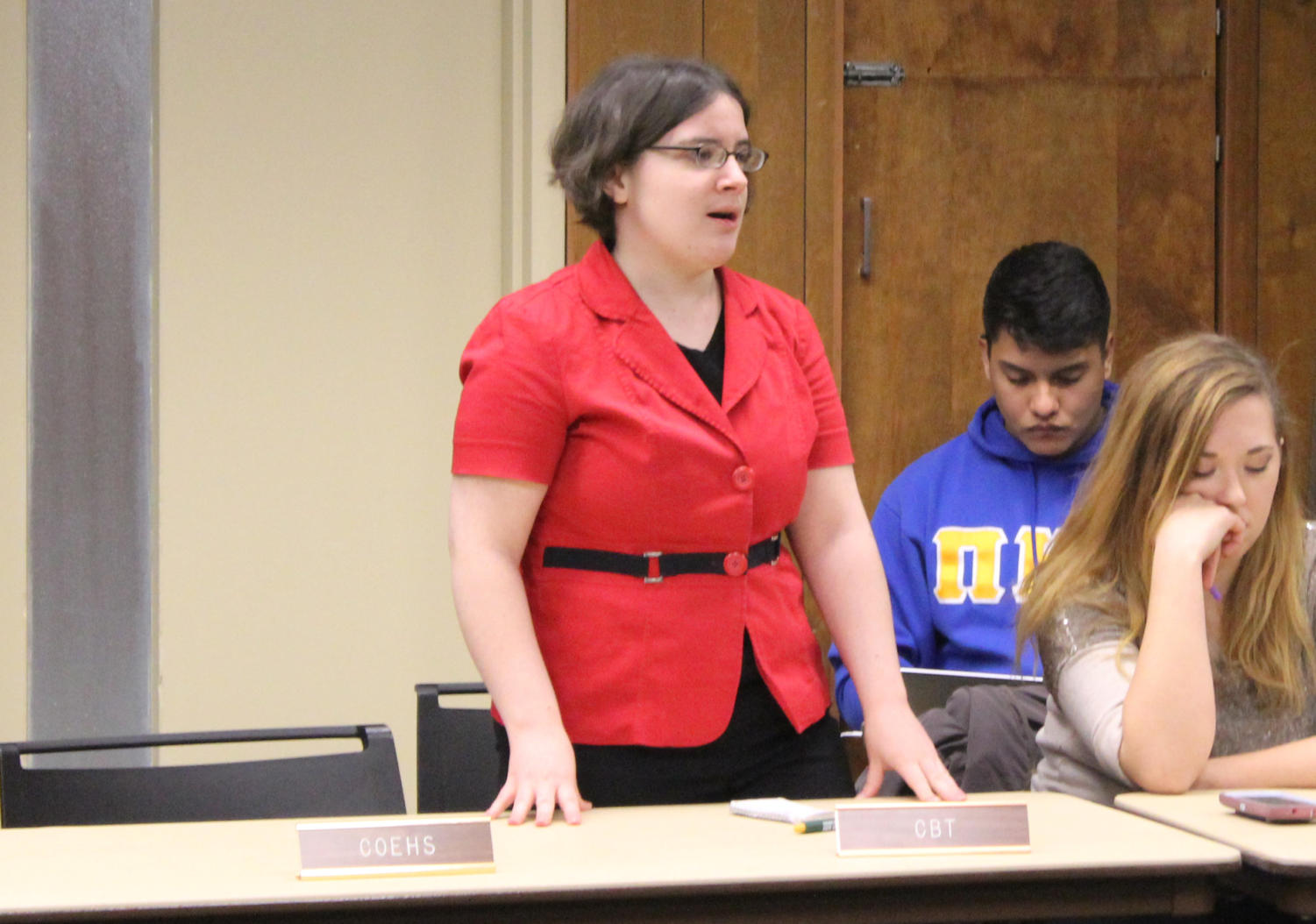 Amanda Wrenn debate legislation on the Student Government Association floor pertaining to participation and attendance policies in the classroom on Tuesday night.