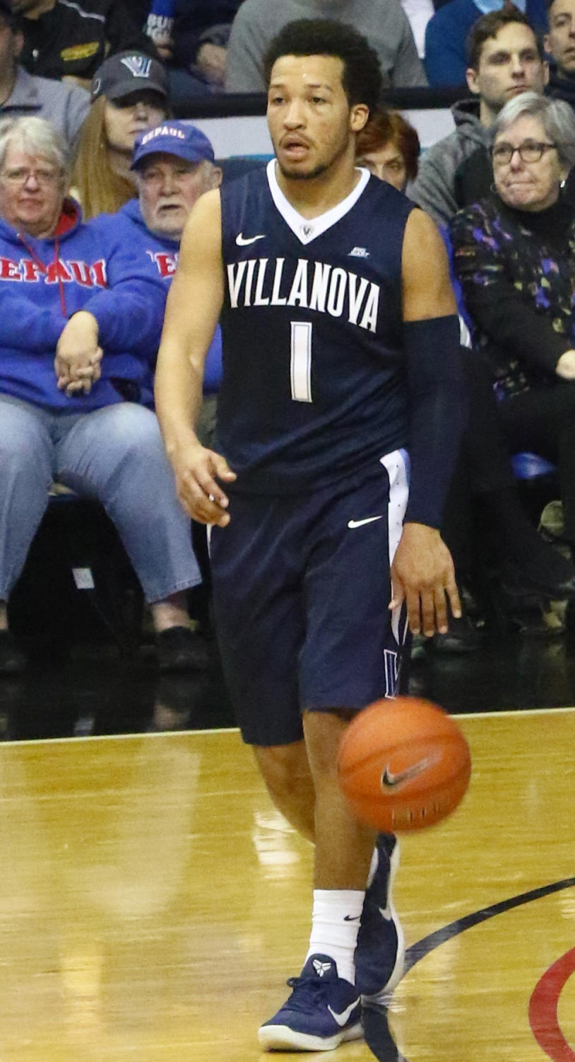 Junior guard Jalen Brunson dribbles down the court.