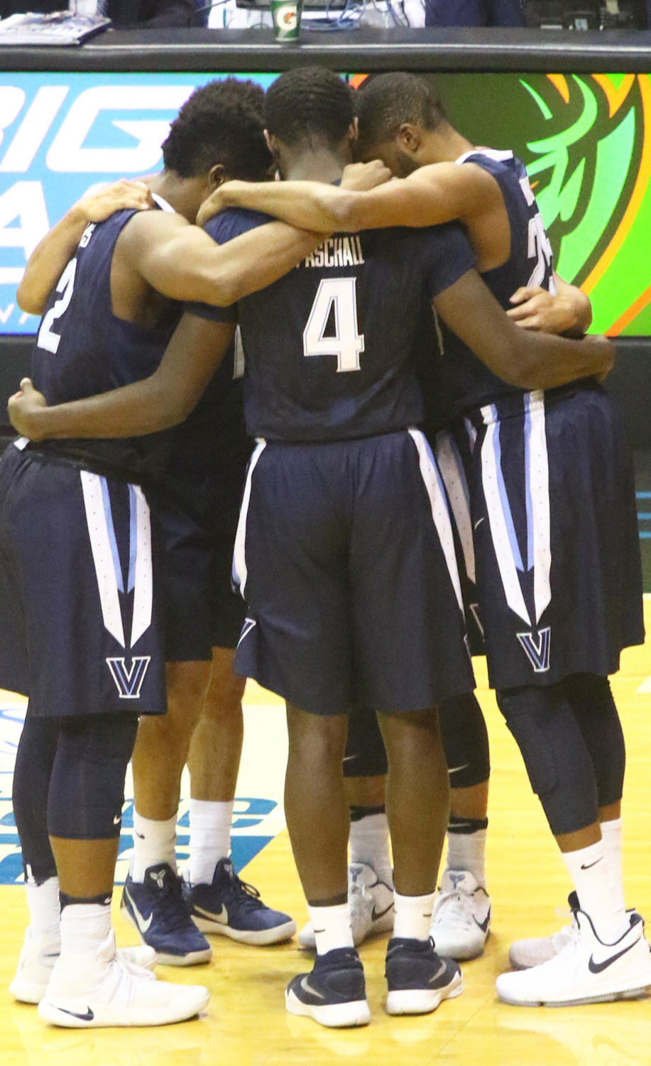 Villanova University's starting five in the huddle before a game.