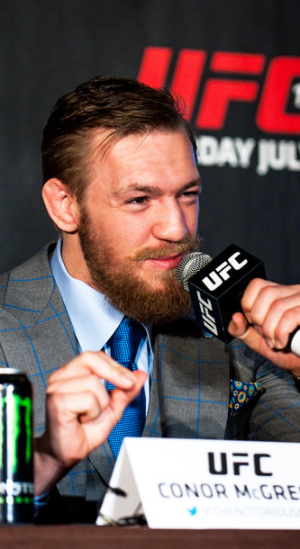 Connor+McGregor+grabs+the+mic+in+UFC+press+conference.