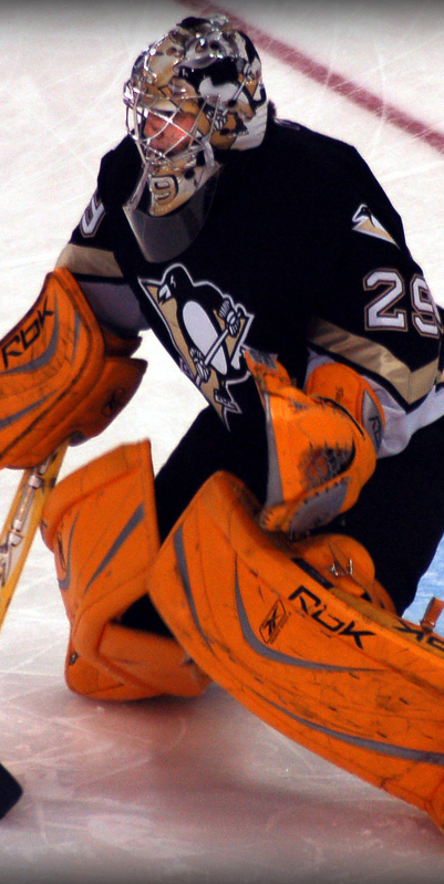 Marc-Andre+Fleury+stops+the+puck+for+his+old+club