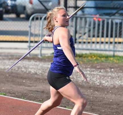 Michaela Busch throws javelin at home meet.