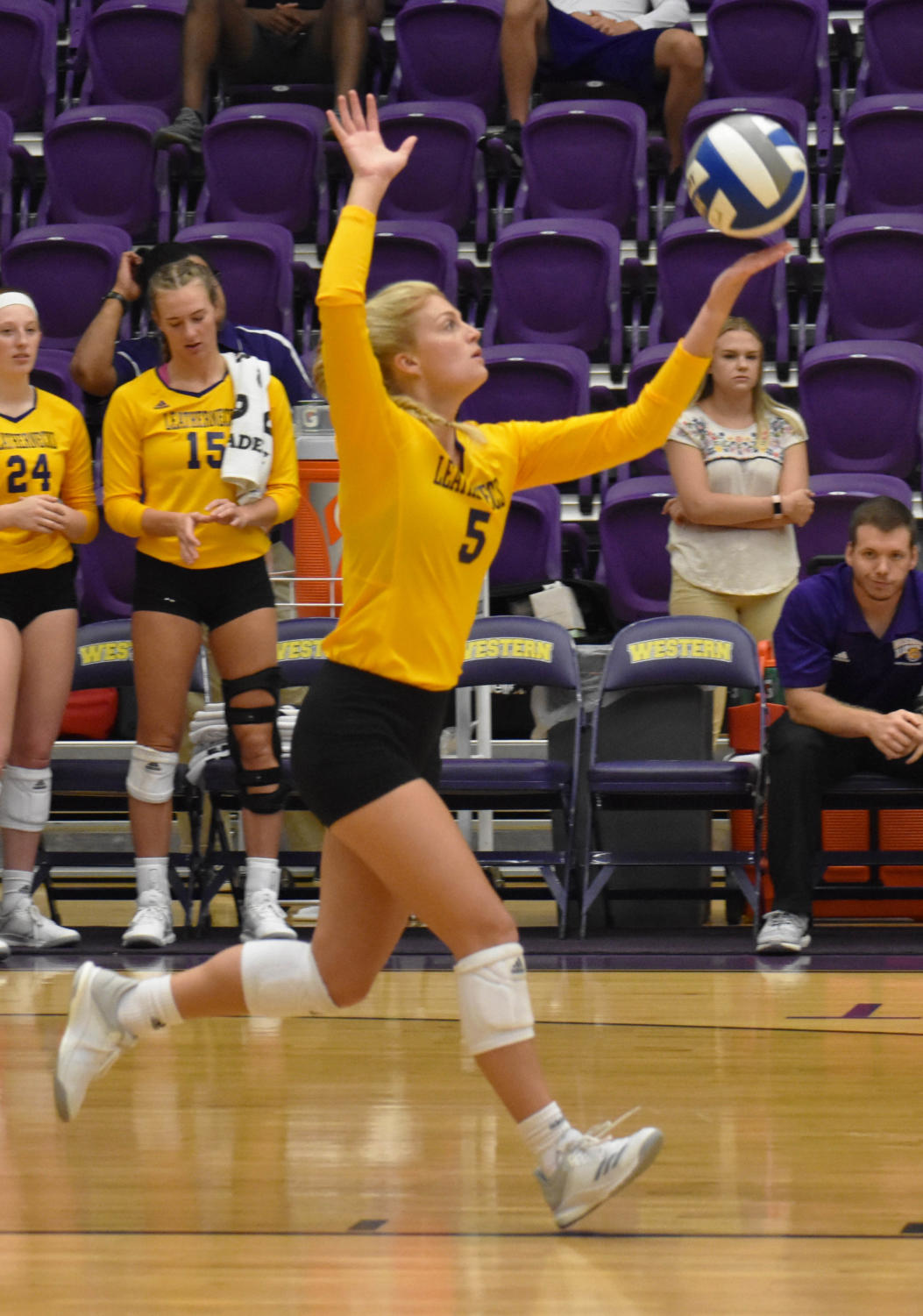 Jaime Johnson serving the ball at a home game.
