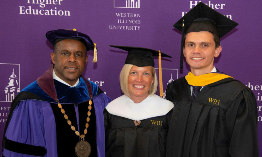 President Jack Thomas, Student Board of Trustee Justin Brown and guest speaker Representative Tony McCombie pose for a picture following the Founders Day program in Sherman Hall Auditorium.