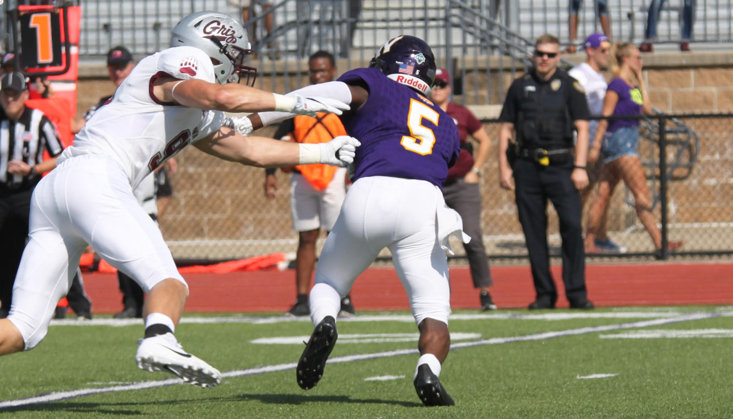 Senior runningback Steve McShane fights off a Montana Griz defender as he looks for more yards in the Leathernecks' home opener.